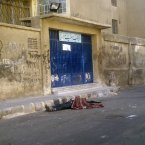 This citizen journalist image shows a dead body lying in the street in the Yarmouk camp for Palestinian refugees in south Damascus, Syria, Saturday, July 21, 2012. (AP Photo)