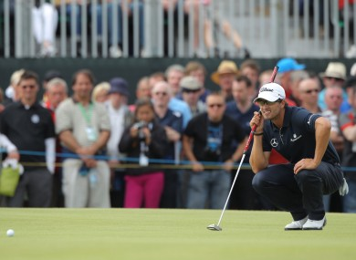 Australia's Adam Scott lines up a putt on the 4th green during day four of the 2012 Open Championship.
