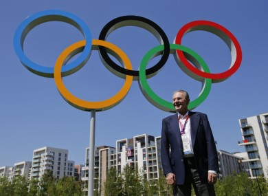 IOC president Jacques Rogge at the Olympic Village. Grindr says the sudden inhabitation of the Olympic Village had nothing to do with its downtime last week.