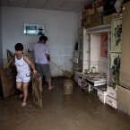 Villagers clean their flood-hit home at a village in Fangshan district of Beijing on Monday (AP Photo/Andy Wong)