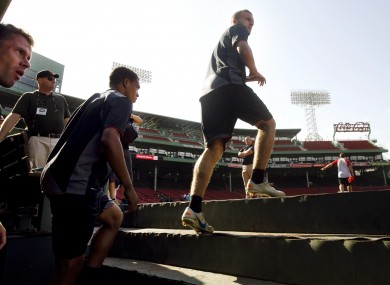 Liverpool players take to the Fenway turf for training yesterday.