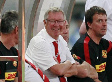 anchester United boss Alex Ferguson smiles after Shinji Kagawa scores against Shanghai Shenhua yesterday.