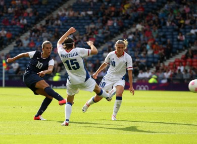 USA's Carli Lloyd scores against France.
