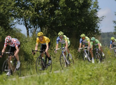 Bradley Wiggins of Britain, wearing the yellow jersey, and Christopher Froome, wearing the best climber's polka-dot jersey.