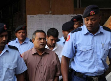 Sandip Mooneea and Avinash Treebhoowoon arriving in court yesterday.
