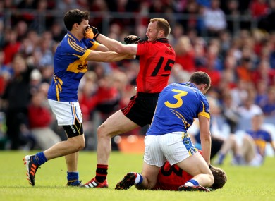 Tipperary's Ciaran McDonald and Paddy Codd clash with Eoin McCartan and Brendan Coulter of Down.
