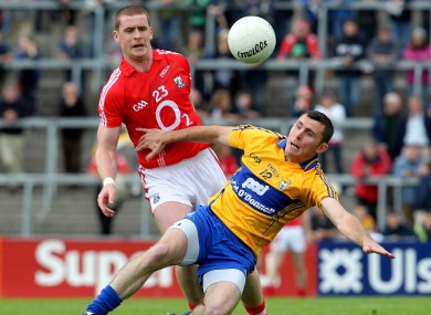 Cork's Fintan Goold challenged by Clare's Alan Clohessy in today's clash.