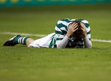 Hoops ace Gary Twigg holds his head after missing a chance against FK Ekranas on Tuesday night.