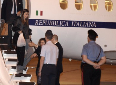 Australian lawyer Melinda Taylor,left, holding a white bag disembarks at Rome's Ciampino military airport.