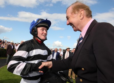 History-maker Jane Mangan is congratulated by the King of Ballybrit, Dermot Weld, after her win in the Carlton Hotel Galway City (Q.R.) Handicap yesterday.