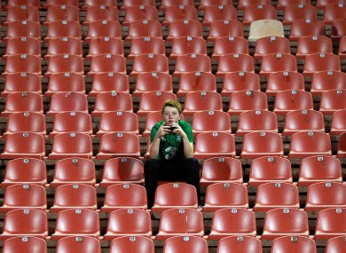 A supporter watches on during Ireland's uninspiring 0-0 draw with Serbia this evening.