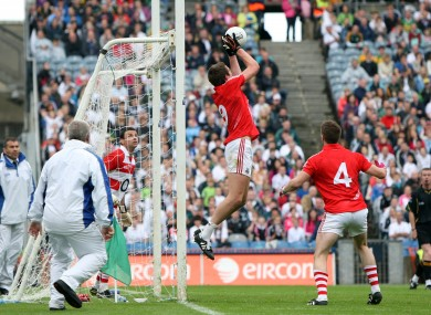  Cork's Aidan Walsh gathers a free that drops short of the crossbar in Sunday's clash with Kildare.