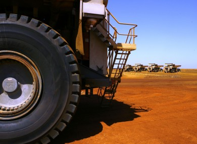 In this photo taken on March 4, 2010, large dump trucks are lined up at Rio Tinto operations at Dampier in Western Australia.