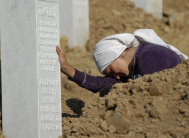 A Bosnian Muslim woman by her relative's graveside at the Potocari memorial, near the former UN base site.
