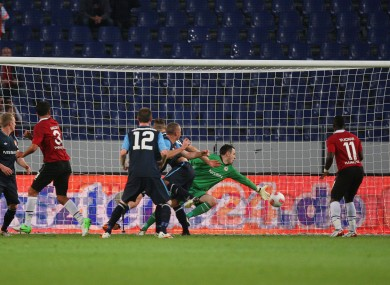 St Pat's goalkeeper Brendan Clarke is beaten by Hannover's Karim Haggui (3) for the opening goal.