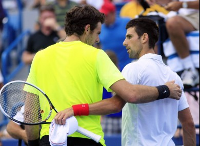 Del Potro and Djokovic chat at the net following the Serbian's win.