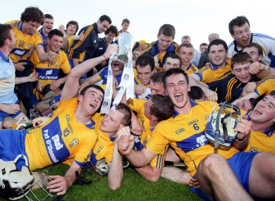 Clare players celebrate with the trophy after last night's game.