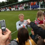 Duff takes time out to sign autographs.