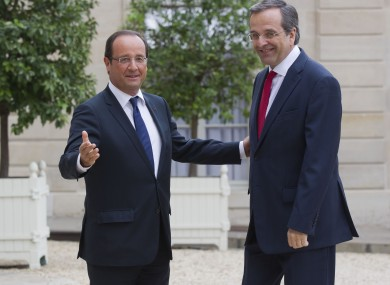 Francois Hollande (left) welcomes Antonis Samaras to Paris.