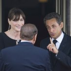 Nicolas Sarkozy laying down the house rules to Silvio Berlusconi before dinner at the G8 summit in France last year. (Chris Ratcliffe/PA Wire)