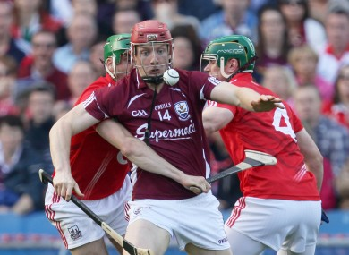 Galway's Joe Canning is tackled by Eoin Cadogan and Brian Murphy of Cork.