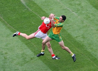 Kavanagh competes against Cork's John Miskella during the 2009 quarter-final.