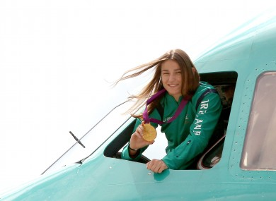 Katie Taylor shows off her Olympic gold medal from the cockpit.