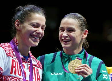 Taylor with silver medalist Sofya Ochigava on the podium.