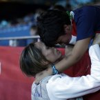 Italy's Valentina Vezzali celebrates with her seven-year-old son Pietro Giuguano after winning a semifinals match against France at women's team foil fencing at the 2012 Summer Olympics, Thursday, Aug. 2, 2012, in London. (AP Photo/Pat Semansky)