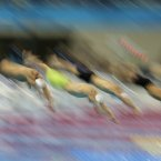 Swimmers start in a men's 100-meter freestyle swimming heat at the Aquatics Centre in the Olympic Park during the 2012 Summer Olympics in London, Tuesday, July 31, 2012. (AP Photo/Matt Slocum)
