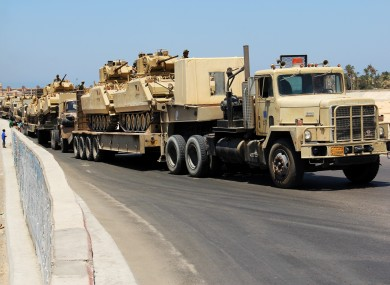 Army trucks carry Egyptian military tanks in El Arish, Egypt's northern Sinai Peninsula, Thursday, Aug. 9, 2012