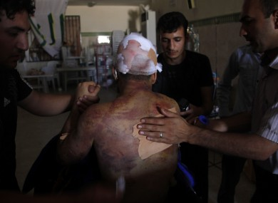 Mahmoud, a 21-year-old Palestinian resident of Syria, receives treatment in a field hospital after he was found Monday, Aug. 6, 2012,