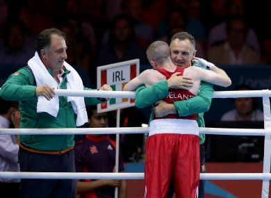 Paddy Barnes is hugged by Team Ireland boxing head coach Billy Walsh.