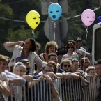 Supporters of feminist punk group Pussy Riot stand behind barricades surrounding a court, in Moscow, Russia on Friday, Aug 17, 2012. (AP Photo/Sergey Ponomarev)