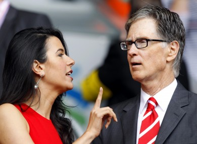 Liverpool director John W Henry and his wife Linda Pizzuti in the stands at Anfield last season.