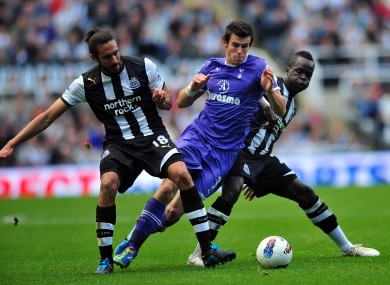 Newcastle's Jonas Gutierrez and Cheick Tiote challenge Gareth Bale of Spurs. 