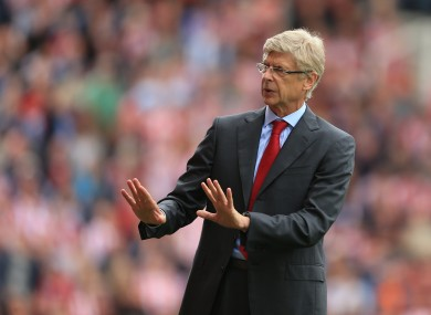 Arsene Wenger gestures to the crowd during his side's scoreless draw with Stoke on Sunday.