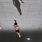 Children take part in a trampoline training session at Zhuzhou City Sports Bureau in Zhuzhou, Hunan Province of China. Amateur sports schools were launched in China during the 1950s to develop the country's sporting prowess, with almost all such schools relying on government funding. (Photo by Chen Jie/ChinaFotoPress)