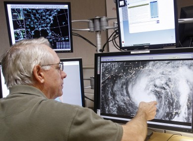 Senior hurricane specialist Stacy Stewart tracks Tropical Storm Isaac at the National Hurricane Center in Miami
