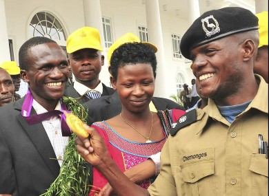 Kiprotich has his medal inspected by a Ugandan officer. 