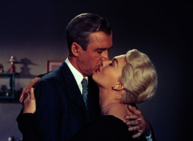 James Stewart and Kim Novak kiss in Alfred Hitchcock's 'Vertigo'.