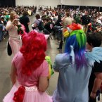 "People dressed in My Little Pony cartoon costumes have their photograph taken at ""BronyCon (AP Photo/Mel Evans)"