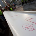 President Barack Obama's signature and thoughts are shown on a steel beam prior to its installation yesterday. (AP Photo/Mark Lennihan/PA)