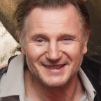 Actor Liam Neeson smiles sheepishly. (AP Photo/Joel Ryan)
