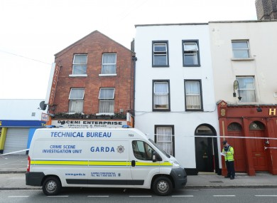 A team from the Garda technical bureau outside the house of Christopher Jackson on Prussia St.