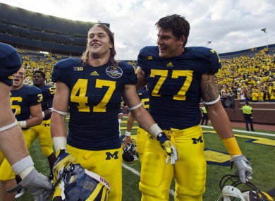 Michigan linebacker Jake Ryan (47) and offensive lineman Taylor Lewan (77) laugh as they walk off the field after an NCAA college football game last weekend.
