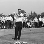 1963: US captain Arnold Palmer throws his putter after missing a putt.