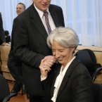Cheeky pinch on the cheek for Christine Lagarde when she was France's finance minister. ( AP Photo/ Thierry Charlier.)