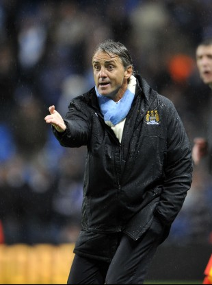 Manchester City's manager Roberto Mancini on the line last night.