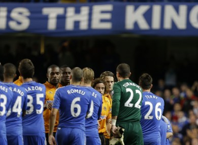 Chelsea's captain John Terry, No 26 shakes hands with the Wolves players.